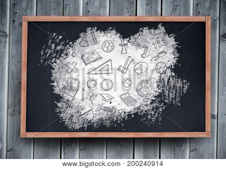 Digital composite of education graphics icons on blackboard