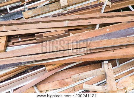 Large lumber pile from the broken house to preparation for renovation the old house.