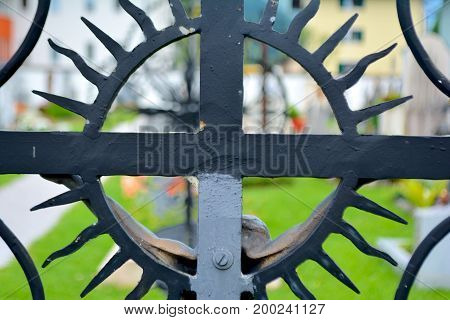 metal cross on cementery close up photo