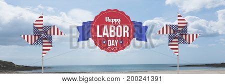 Digital composite of Happy labor day text and USA wind catchers in front of sea
