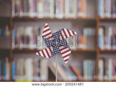 Digital composite of USA wind catcher in front of bookshelf