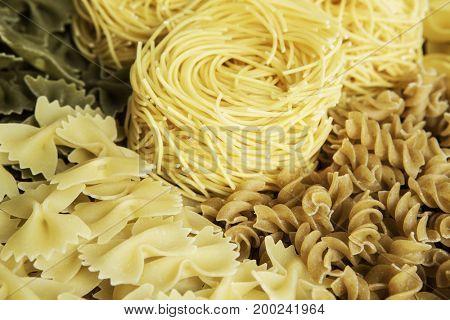Close of uncooked macaroni . Mixed media
