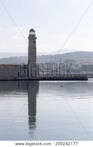 The old lighthouse in the evening light (city Rethymno, island Crete, Greece)