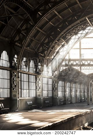 Vntage old-style architectural romantic train station. Light ray inside railway station. Modern fashion architecture