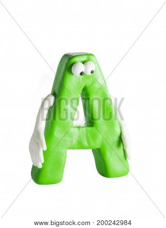 Isolated letter A. Green clay letter anthropomorphic face and hands.