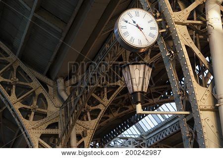 Urban clocks on trainstaion construction. Time waiting for the train.