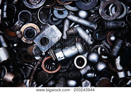 Abstract background of metal nuts, metal products, bolts, studs, washers.
