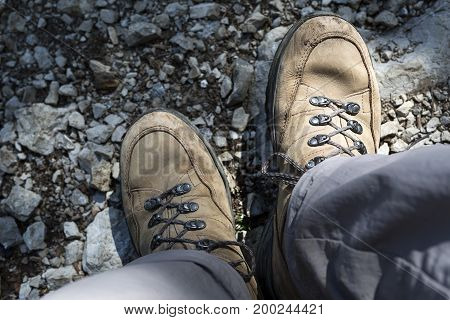Brown hiking shoes in the mountains, sports