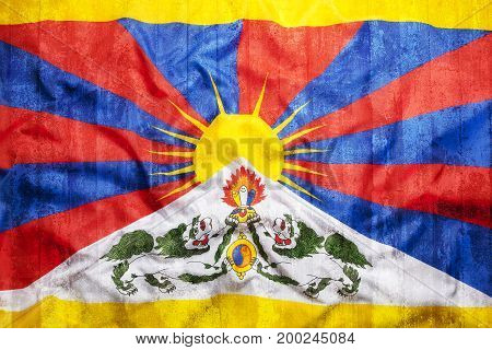Grunge Style Of Tibet Flag On Brick Wall