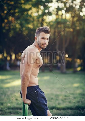 Handsome strong man posing with a bare torso