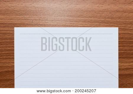 White line paper with space for text on brown wooden table top view