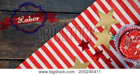 Digital composite image of happy labor day banner against decorated cupcakes with fourth of july theme