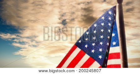 American flag over white background against cloudy sky over countryside