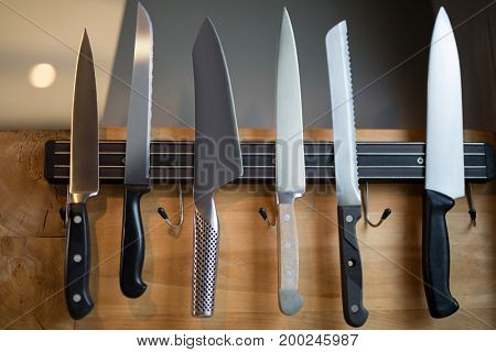 Close-up of kitchen knives hanging on the wall