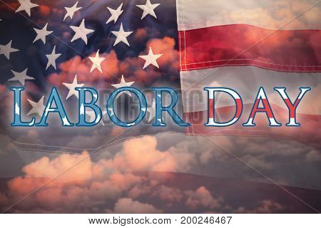 Poster of  labor day text against cloudy sky landscape