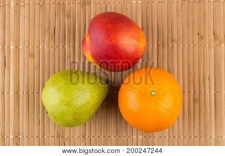 Tangerine, Pear And Nectarine On Bamboo Mat