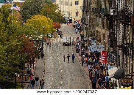 Savannah GA USA -- November 9 2014 -- A look down at a busy Front Street in Savannah GA on a fall afternoon. Editorial Use Only.