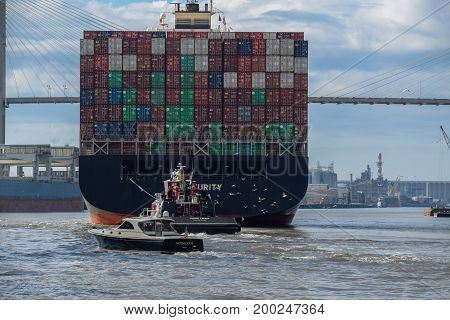 Savannah Georgia USA -- November 9 2014 A Giant Cargo Ship steams up the Savannah River. Editorial Use Only