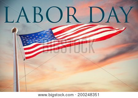 Labor day text  against cloudy sky landscape