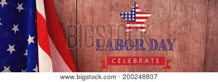 Labor day celebrate text and star shape American flag against american flag on a wooden table
