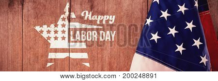 Composite image of happy labor day text and star shape American flag against american flag on a wooden table