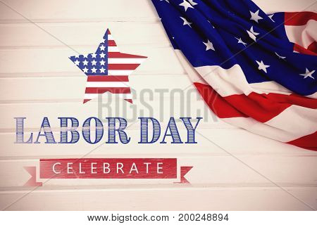 Labor day celebrate text and star shape American flag against close-up of an american flag