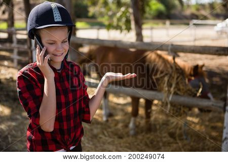 Girl talking on phone at the ranch