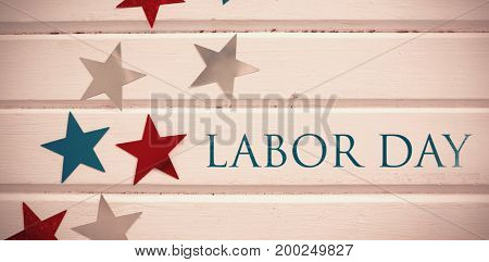 Labor day text  against close-up star shape decorations