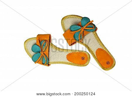 Women's, orange sandals on a white background closeup