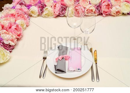 Rolled Gray Table Napkin Tied With Pink Ribbon And Bar Of Chocolate With Blank Space For Text On Whi