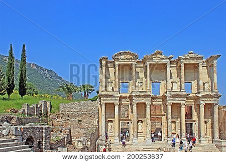 SELCUK, TURKEY - APRIL 30, 2012: Unidentified tourists visit greek-roman ruins of Ephesus. Ephesus applies for UNESCO permanent list membership as one of the most visited places in Turkey