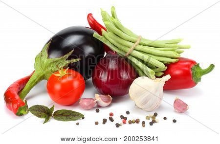 Assortment of fresh raw vegetables isolated on white background. Tomato, eggplant, onion, chili pepper, garlic, spices.