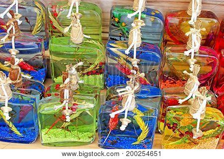 Little glass bottles with colored liquid at a souvenir shop