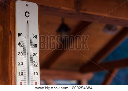 View of outdoor thermometer. Extreme temperature in the shade. 42 degrees Celsius - 107.6 Fahrenheit