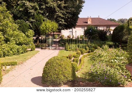 Beautiful Alley In The Garden Leads To The House Through A Garden In The Fashion France