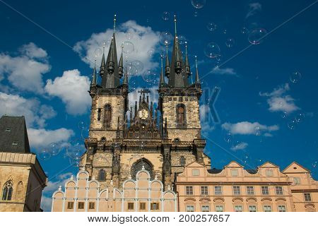 Soap bubbles in the old town Staromestska square in Prague, background of Church Of Our Lady Before Týn