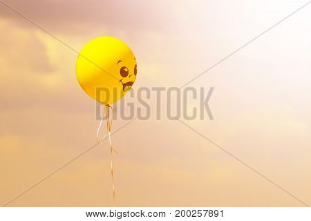 yellow balloon at sunset on a background sky