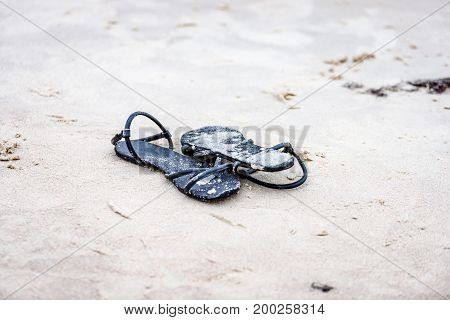 Black Shoes In The Beach