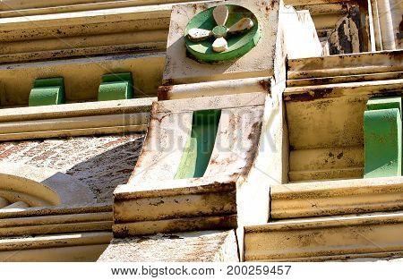 Nineteenth century brick building upper painted facade