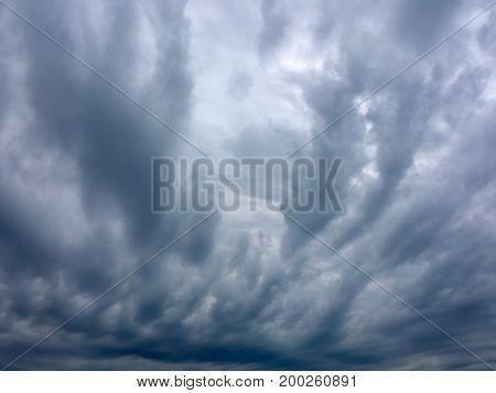 Heavy overcast dark blue and white altocumulus
