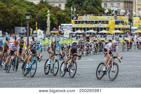Paris France - 23 July 2017: Warren Barguil in Polka Dot Jersey Albert Timmer of Team Sunweb and Romain Bardet of AG2R La Mondiale Team riding in the peloton in Place de la Concorde in Paris during the last stage of Le Tour de France 2017. Bardet finished