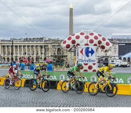 ParisFrance - 23 July 2017: Christopher Froome in Yellow JerseyMichael Matthews in Green Jersey Daryl Impey of Orica-Scott Team and Tony Martin of Katusha-Alpecin Team riding in the peloton in Place de la Concorde in Paris during the last stage of Le Tour
