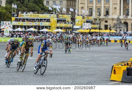 ParisFrance - 23 July 2017: The breakaway in front of the peloton rding in Place de la Concorde in Paris during the last stage of Le Tour de France 2017.