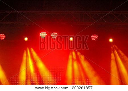 Stage Spotlight with rays. Concert lighting background