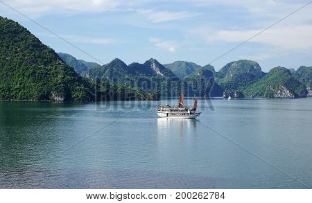 View Of Green Islands In Halong Bay At Day From A Distance With With Boats On The Water, Unesco Worl