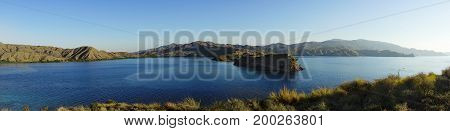 Panoramic View From The Top Of A Mountain At Gili Lawa Overlooking Other Mountains At The Coast With