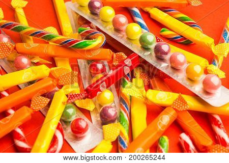 Candies In Packs On Red Background