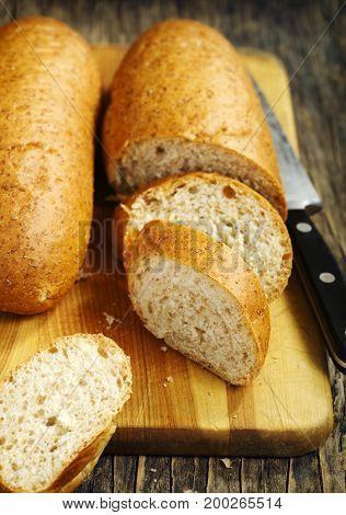 Sliced multigrain bread on a cooking board.