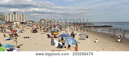 BROOKLYN NEW YORK USA - AUGUST 16: Wide view of beach during summer at Coney Island. Taken August 16 2017 in New York.