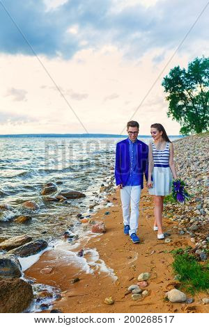 Couple Holding Hands Walking Away. romantic boyfriend